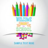 Welcome back to school hand-drawn greeting with. Color pencils under the paper ribbon Stock Photos