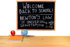 Welcome Back to School ? Physics Class. Black Chalkboard, written congratulation for Back to School, thematic of the Physics Class, visualization of the Newton Stock Images