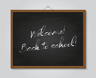 Welcome back to school poster with chalkboard Stock Photo