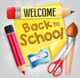 Welcome Back to School with School Supplies and a Piece of Yellow Paper Stock Photos