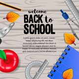 Welcome back to school with stationary with autumn fall leaves on the wood background. Welcome back to school with stationary pencil, compass, scissors, apple stock image