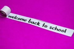 Welcome Back To school text, Inspiration, Motivation and business concept on purple torn paper royalty free stock images