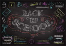Welcome Back To School Typographical Background On Chalkboard With School Icon Elements Royalty Free Stock Photography