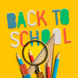 Welcome back to school on yellow background Royalty Free Stock Images
