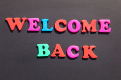 Welcome Back. Written with alphabet letters on a blackboard Stock Images