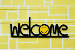 Welcome. On Background of yellow brick, wood Royalty Free Stock Photography