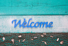 Welcome beach sign with shells and sand Royalty Free Stock Photos