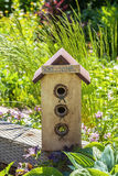 Welcome Birdhouse. A wooden birdhouse with a welcome sign for new nesters Royalty Free Stock Photo