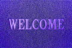 Welcome Blue Door Mat. Welcome Carpet Background. Royalty Free Stock Photography
