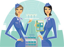 Welcome on board!. Two beautiful air hostess waiting for passengers Royalty Free Stock Images