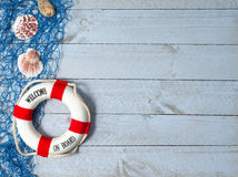 Welcome on Board - lifebuoy with text and shells on wooden background. Copy space for individual text stock photos