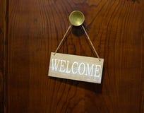 Welcome board on the wooden door stock photos