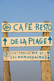 Welcome cafe sign on the beach with blue sky Stock Image