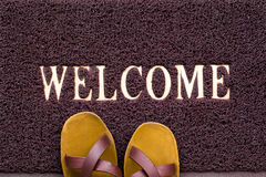 Welcome carpet with beach shales on it Royalty Free Stock Image