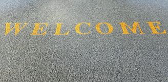 Welcome carpet. Yellow welcome on black carpet Royalty Free Stock Photos