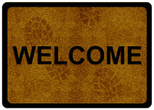 Welcome cleaning foot carpet. With shoe print on it Royalty Free Stock Photo