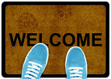 Welcome cleaning foot carpet. With shoeand shoe print on it Royalty Free Stock Photography