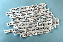 Welcome collage. Welcome Word Cloud printed on paper on blue font stock images