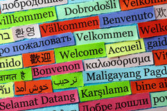 Welcome collage. Welcome Word Cloud printed on paper on blue font royalty free stock photography