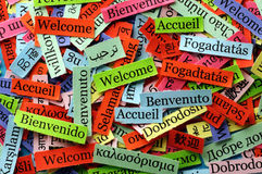Welcome collage. Welcome  Word Cloud  printed on  paper on blue font Stock Photo