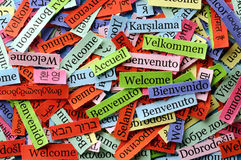 Welcome collage. Welcome Word Cloud printed on paper on blue font stock photos