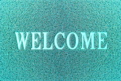 Welcome Cyan Door Mat. Welcome Carpet Background. Royalty Free Stock Images
