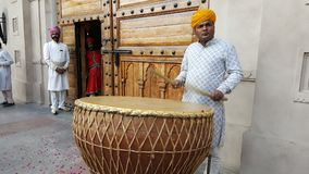 Welcome Dhol, the traditional percussion instrument of Rajasthan. A man beats rhythm on a Nagara drum. The nagara or naghara is the most widespread of the stock images