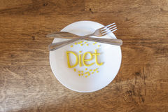 Welcome diet. Diet day. Dish, knife and fork with the word Diet Royalty Free Stock Image