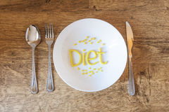Welcome diet. Diet day. Dish, knife and fork with the word Diet Royalty Free Stock Photo