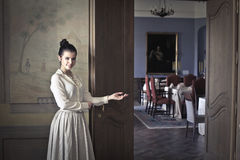 Welcome dinner. Woman welcoming guests to dinner Royalty Free Stock Photo