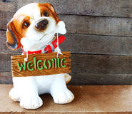 Welcome dog on wooden background still life Stock Photo