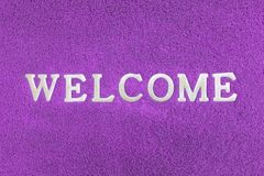 Welcome doormat blue color. Background Stock Image