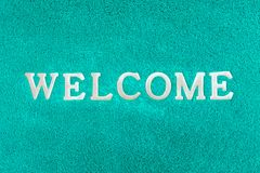 Welcome doormat blue color. Background Royalty Free Stock Photography