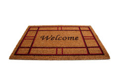 Welcome doormat or carpet on white Stock Photography