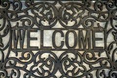 The welcome doormat. Front door Stock Image