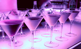 Welcome drink in a night club - bar counter. Welcome drink in a night club cocktails on illuminated bar counter Stock Photos