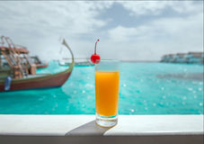 Welcome drink. Orange juice and fresh cherry and sea view on water villa, Maldives stock images