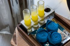 Welcome drink with small towel set. Royalty Free Stock Photography