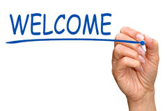 Welcome - female hand writing blue text with marker. On white background stock photo