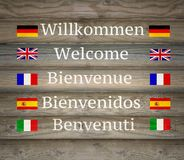 Welcome in five languages on the Signboard Stock Photography