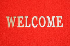 Welcome Floor Mat. Floor Mat With Welcome On A Red Background Stock Images