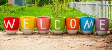 Welcome on flowers pot Stock Image