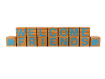 Welcome Friends. Photo of the words welcome friends spelled out on wooden blocks, isolated on white Royalty Free Stock Photography
