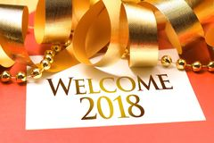 Welcome 2018 with gold decoration. We wish you a new year filled with wonder, peace, and meaning Royalty Free Stock Photos