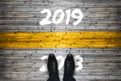 Welcome 2019 - Goodbye 2018 - Start Concept. Welcome 2019 - Goodbye 2018 - New Year Start Concept stock photography