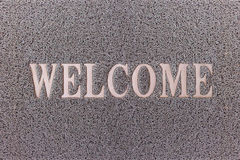 Welcome Gray Door Mat. Welcome Carpet Background. Royalty Free Stock Photo