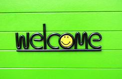 Welcome. On  green  background. wood Royalty Free Stock Images