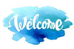 Welcome hand drawn lettering against watercolor Stock Images