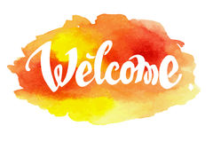 Welcome hand drawn lettering against watercolor Stock Photo