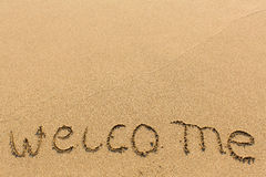 Welcome - hand-written on sandy beach. Travel. Royalty Free Stock Photo